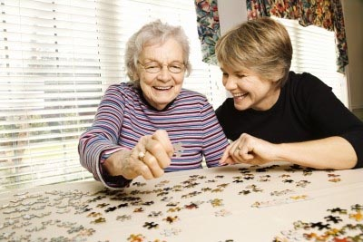 Two women doing a puzzle